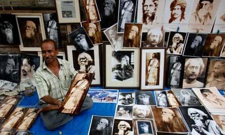 A street vendor sells photographs of Tagore