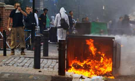Garbage burns during the riots in Hackney, London