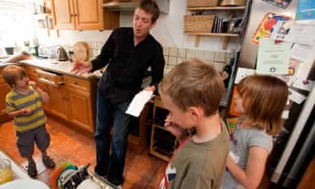 Mike Power contemplates the dishwasher with the three children