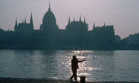 Ebb and flow ... a man fishes in the Danube opposite the Hungarian Parliament Building in Budapest.