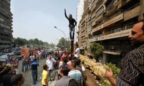 An Egyptian shouts slogans