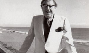 Herbert Lomas in a white jacket by the sea