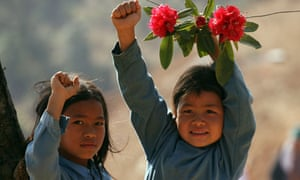 Nepalese girls give a Maoist salute during celebrations