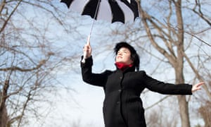 The Night Circus author Erin Morgenstern appearing to float with a black-and-white umbrella