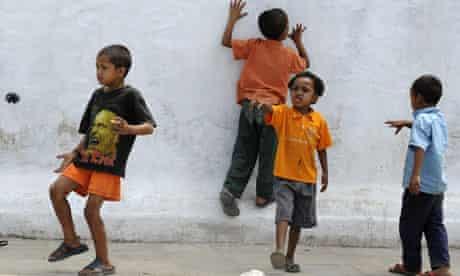Nepalese children play on a street in Kathmandu