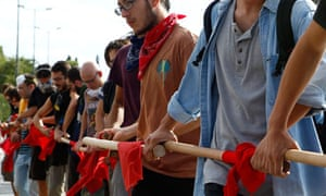 Greek students form a human chain during a protest march in Athens