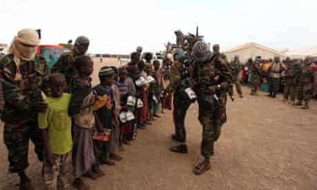 Al-Shabaab fighters distribute relief to internally displaced people at K50 camp