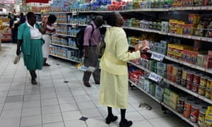 Zimbabweans shop in a supermarket