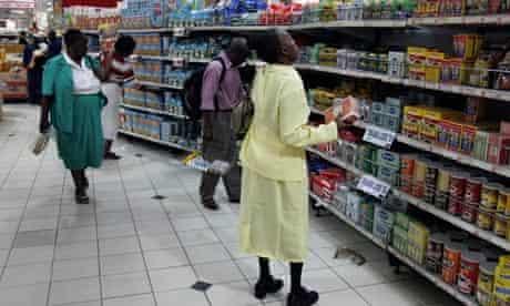 Zimbabweans shop in a supermarket