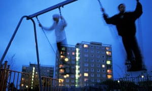 Youths play on swings at dusk on Hartcliffe Estate
