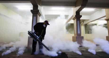 Malaysian health official sprays anti mosquito spray