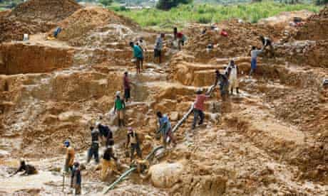 Workers at a diamond mine in Sierra Leone