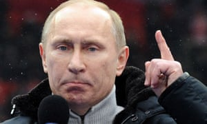 Prime Minister Vladimir Putin delivers a speech during a rally of his supporters in Moscow