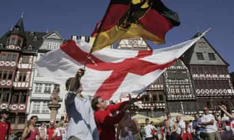Soccer fans wave German and English flags in Frankfurt