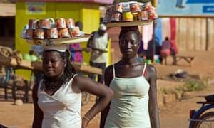 African girls sell coffee in Ouagadougou, Burkina Faso