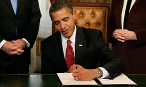 Barack Obama signs his first act as president in the US Capitol building on 20 January 2009