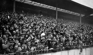 Football supporters watch an FA Cup game between Arsenal and Darwen in 1932