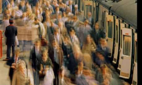 Commuters on railway station platform (blurred motion)