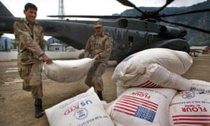 World Food Programme wheat is unloaded from a US navy helicopter in Pakistan