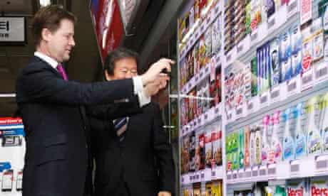 Britain's Deputy PM Clegg tries out a virtual store at a subway station in Seoul