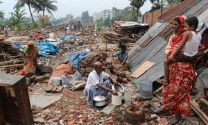 Families in Dhaka's Korail slum