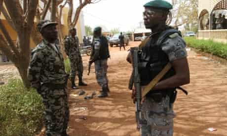 Malian soldiers stand in guard in Kati