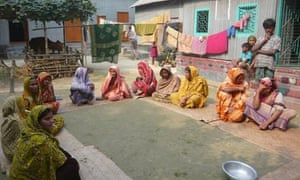 Women discuss microfinance in a village near the Bangladesh capital, Dhaka
