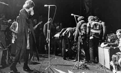 Mick Jagger on stage at Altamont as violence breaks out
