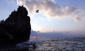 Boys dive into the Mediterranean from Cleopatra's Rock, on the Egyptian coast 500km north of Cairo.
