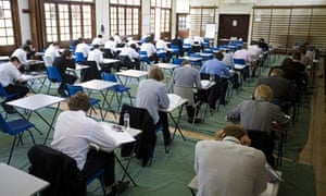 Schoolchildren sitting an exam in a school hall