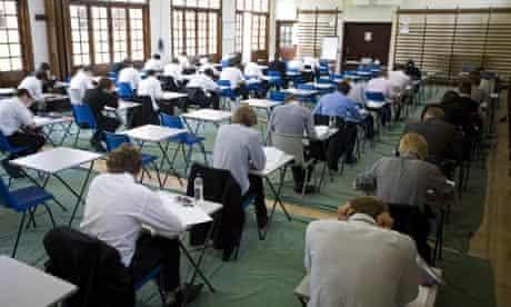 Schoolchildren sitting an exam in a school hall