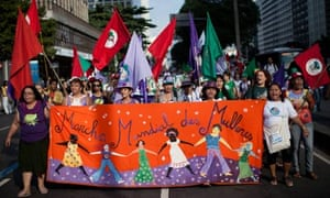 Women march at a rally for women's rights during the Rio+20 conference