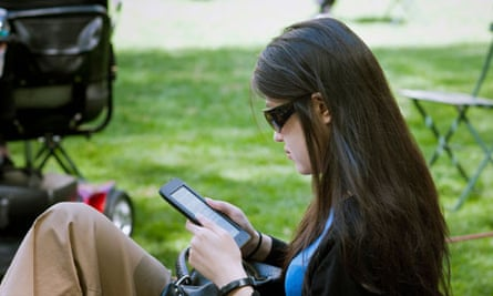 Between the lines … a reader with a Barnes & Noble Nook.