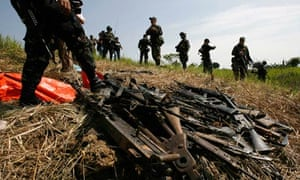 Philippine soldiers recover illegal weapons from a private army