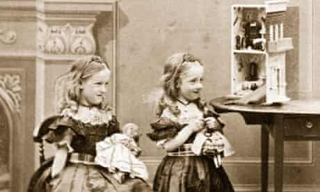 Victorian girls playing with dolls