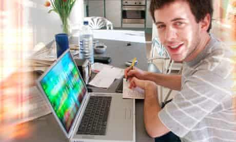 Teen writing at laptop