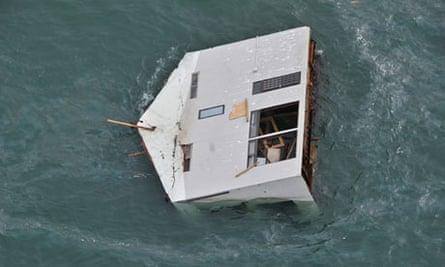 A house adrift off the coast of north eastern Japan following the earthquake and tsunami