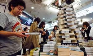 Japanese readers flip through Japanese novelist Haruki Murakami's new book
