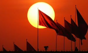 Chinese military personnel watch over Tiananmen Square