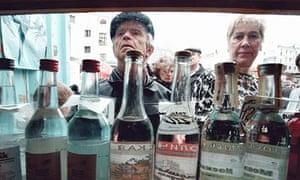People buy vodka in a Moscow street kiosk