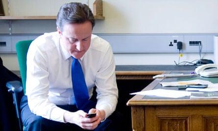 David Cameron using his mobile phone