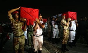 Egyptian soldiers carry coffins of their colleagues on 19 August.