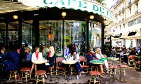 Patrons at the famous Cafe de Flore, on the corner of Boulevard Saint-Germain and Rue St Benoit in P