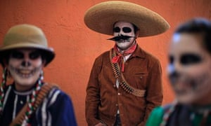 Women dressed as escaramuzas, also known as cowgirls, and a charro horseman in Mexico City, 2010.