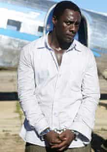 Idris Elba and Riaad Moosa in <em>Mandela: Long Walk to Freedom</em> (2013).