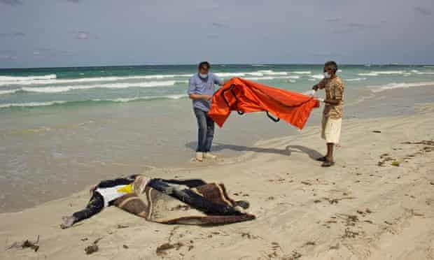 A body on the beach at Zuwara.