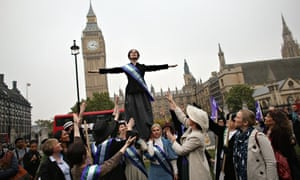 Campaigners, some dressed as suffragettes, attend a rally organised by UK Feminista to call for equa