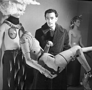 Salvador Dalí holding an artist's lay figure, International Exhibition of Surrealism, Paris, 1938.