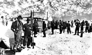 SIR ERNEST SHACKLETON at left at Ocean Camp in 1915