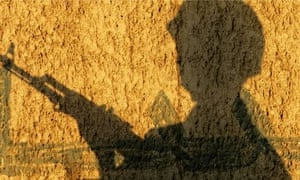 The shadow of an Iraqi soldier securing